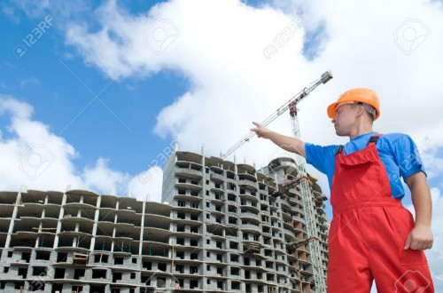۷۶۸۲۵۸۸-engineer-worker-directing-up-with-finger-to-building-under-construction-Stock-Photo